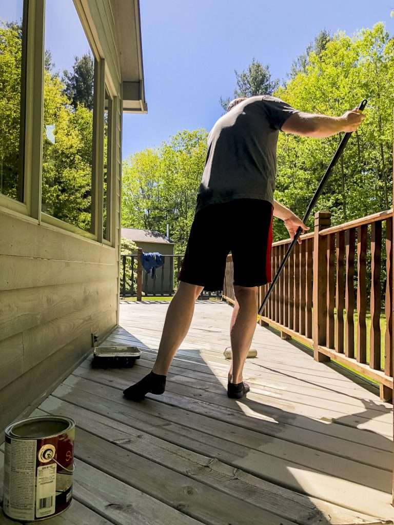 Aaron painting the deck.