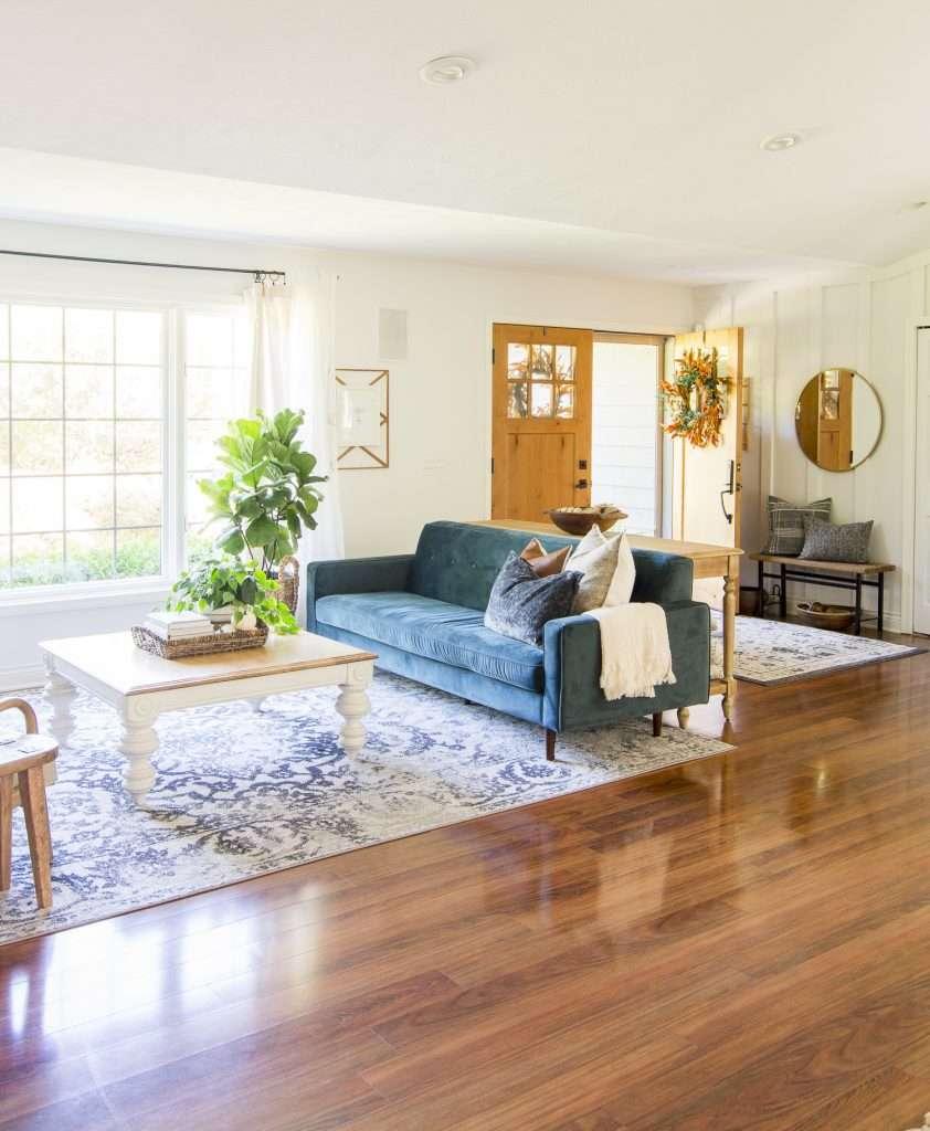Velvet sofa in a mid-century modern living room.