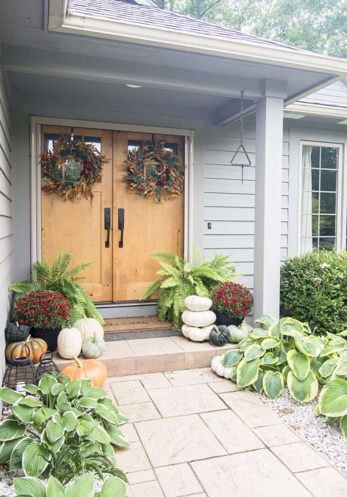 Double doors with fall decor.