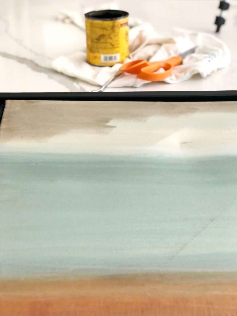 Apply stain to painting.
