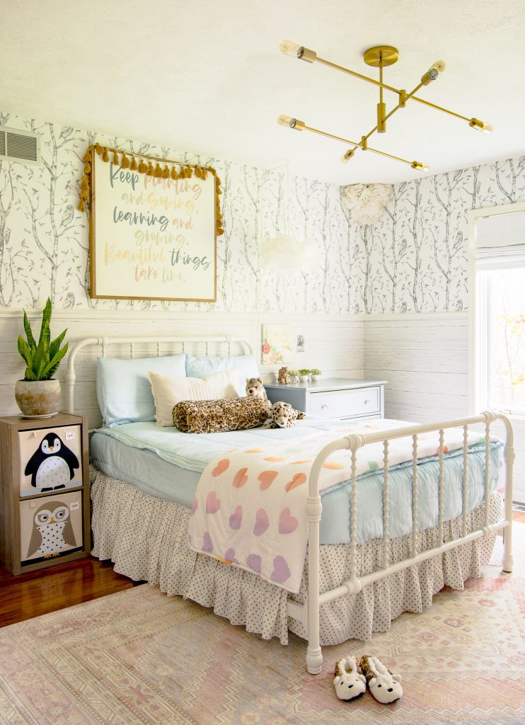 Little girl's room with live plant.