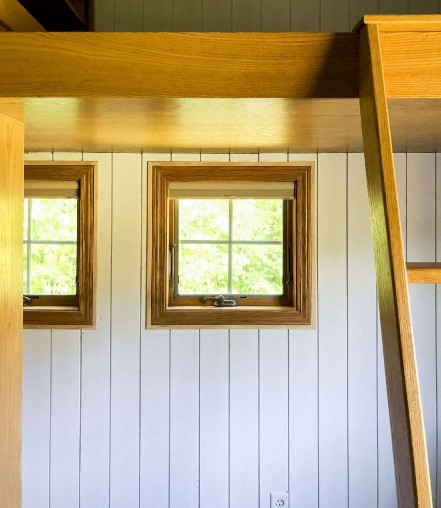 Window trim on a shiplap wall.