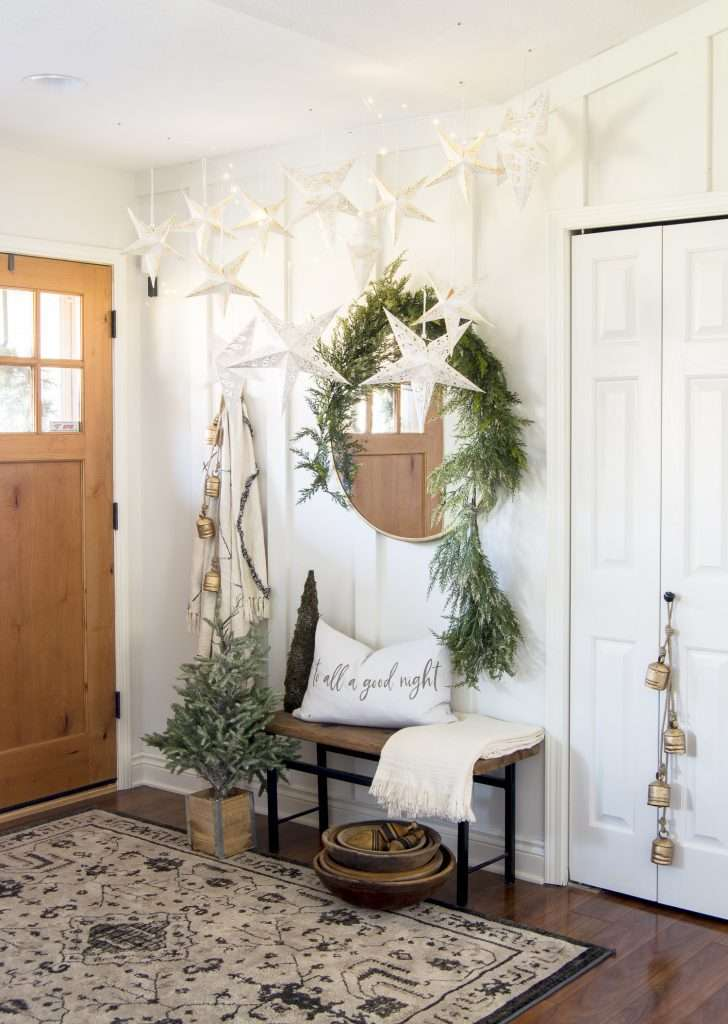 Christmas star decorations in an entryway.