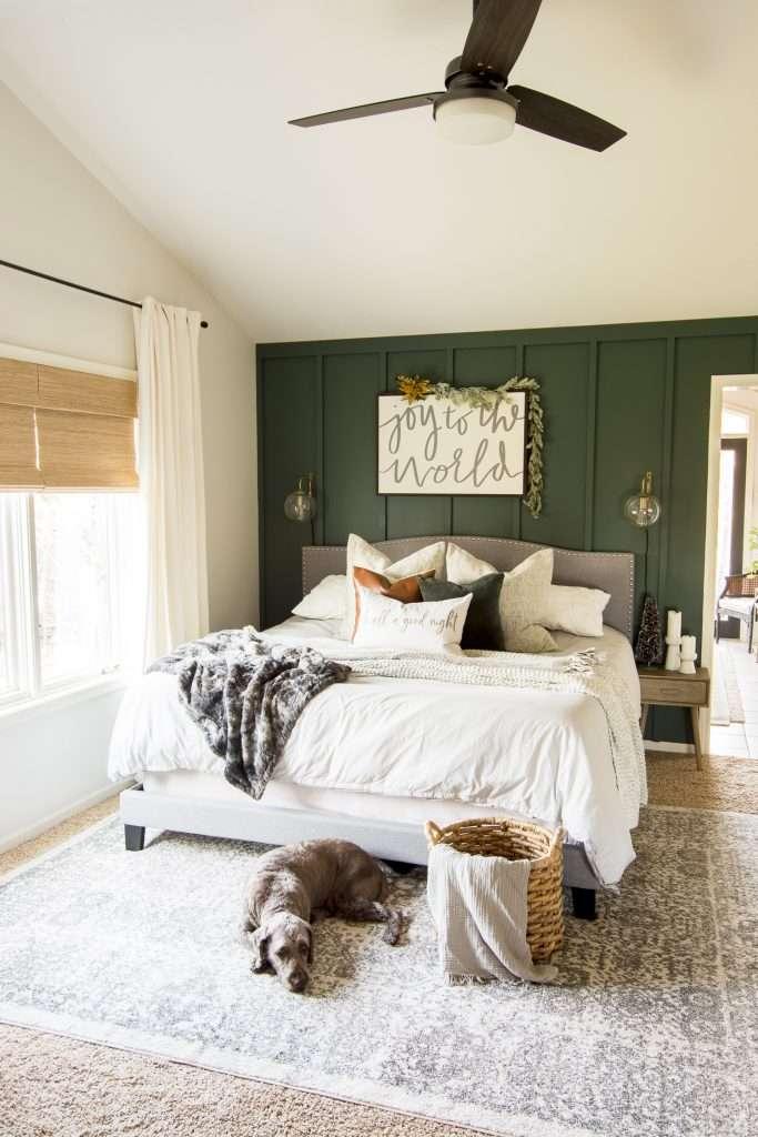 Adding garland to Christmas bedroom decor.