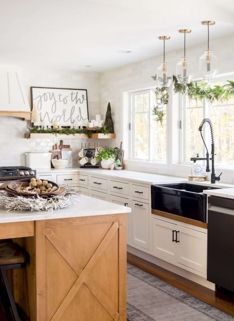 Modern farmhouse kitchen decorated for the holidays.