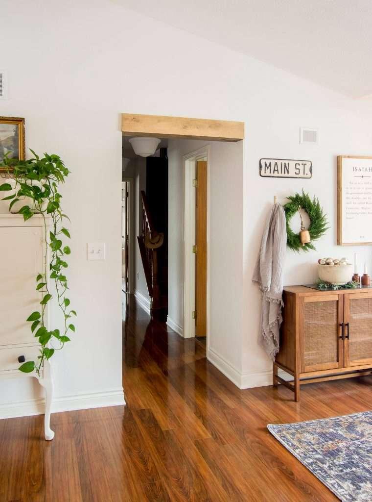Doorway header wrapped in wood.