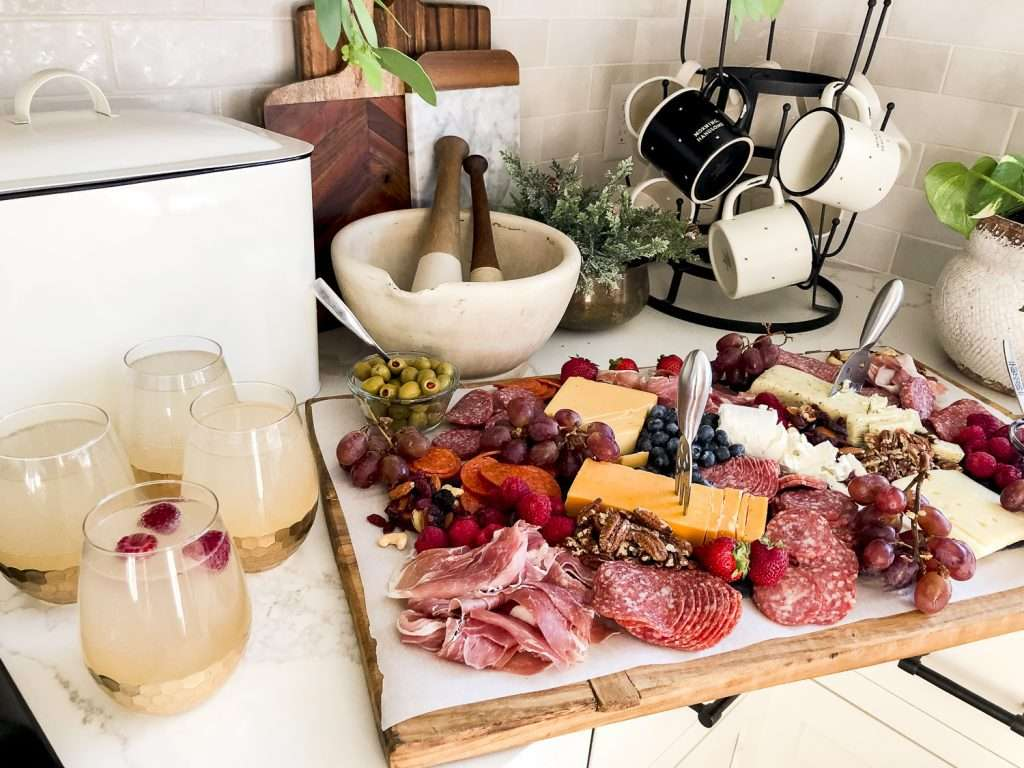 Charcuterie board pairing with mock champagne punch.