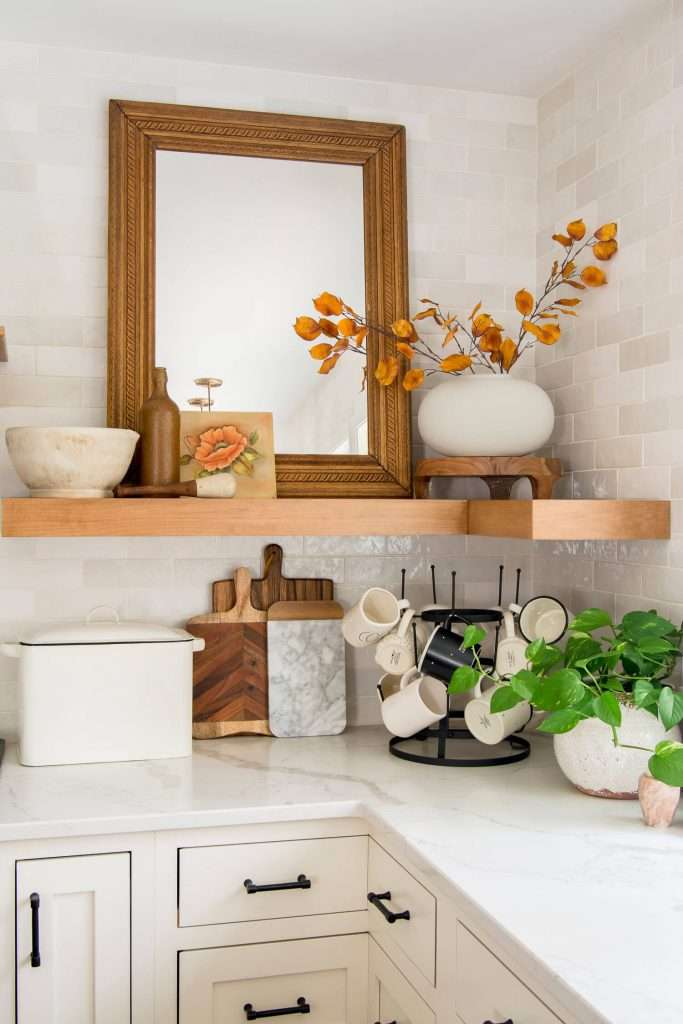 Fall decor on floating kitchen shelves.