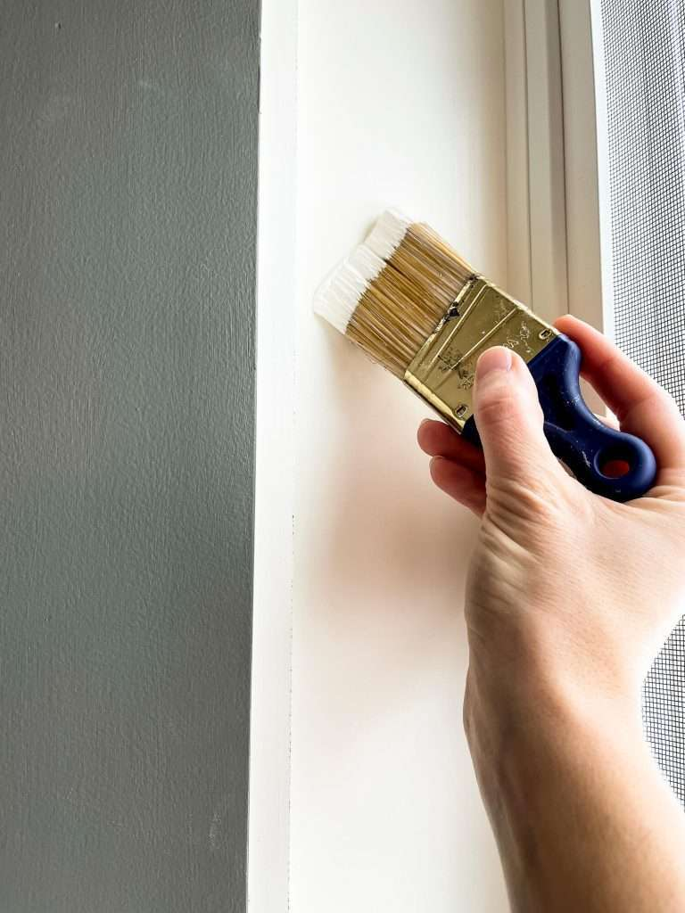 Painting trim with an angled brush.