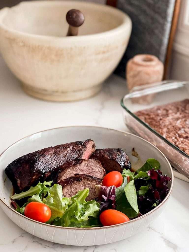 Venison backstraps with salad.