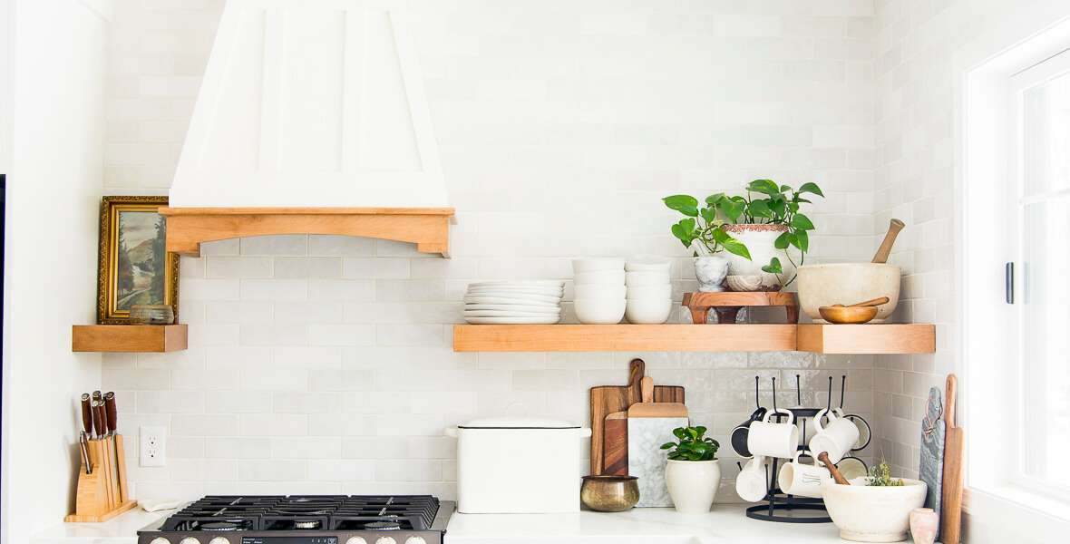Floating kitchen shelves decorated with dishes.