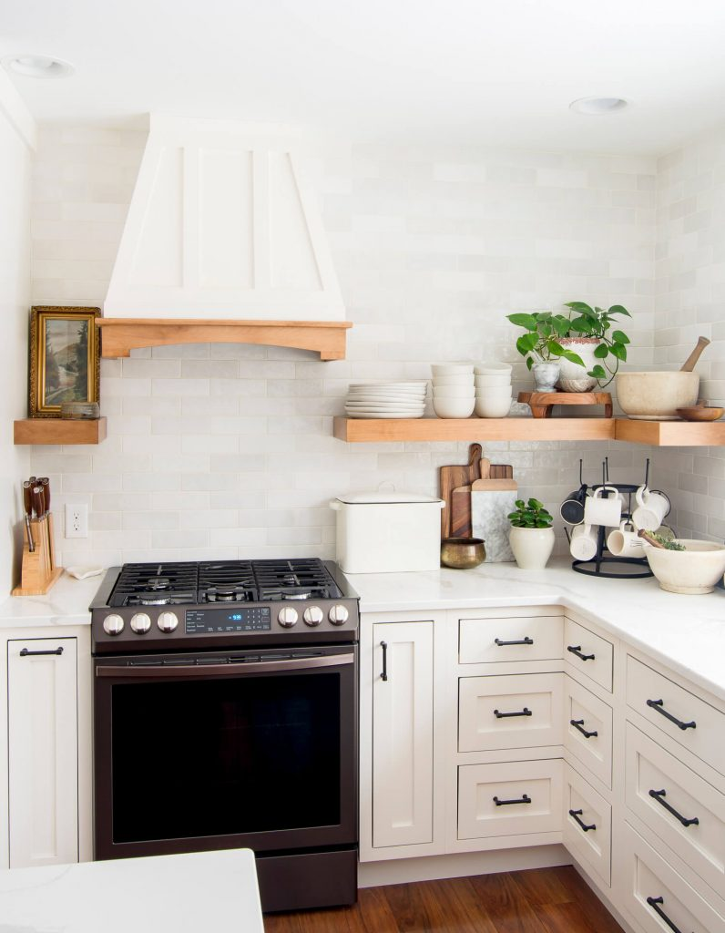 White kitchen cabinets and open shelving.