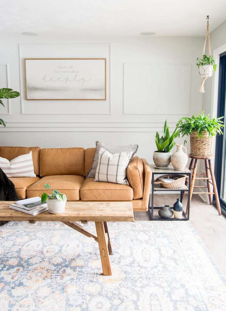 Vintage modern decor with a leather couch.