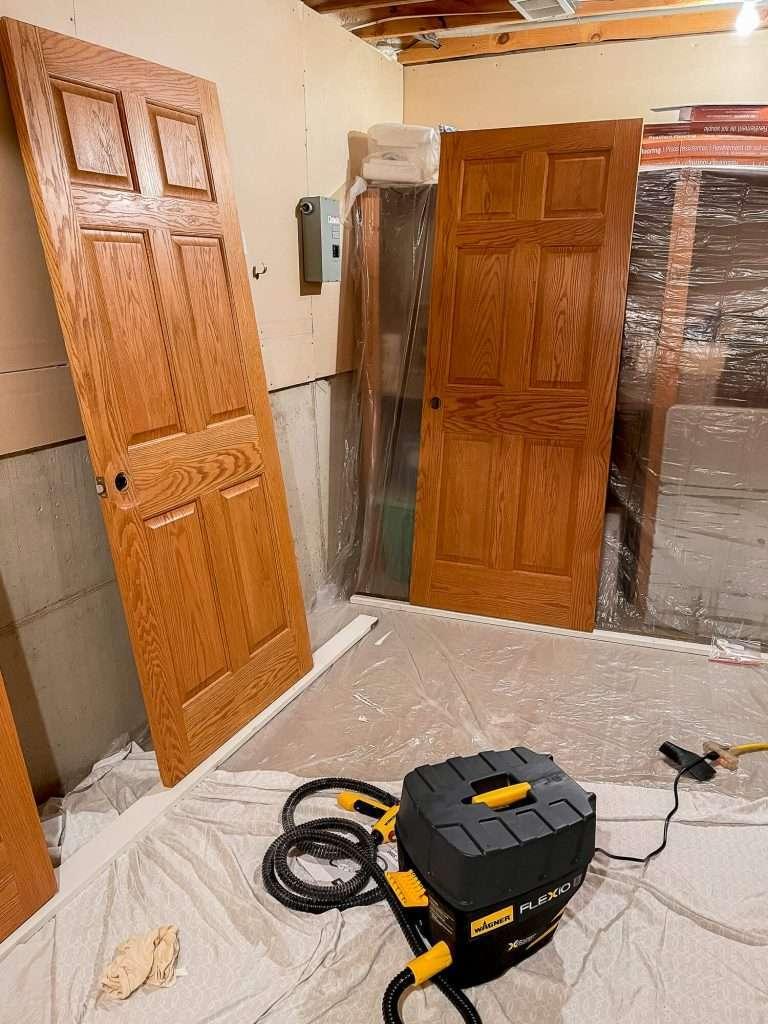 Prepared doors for spray painting.