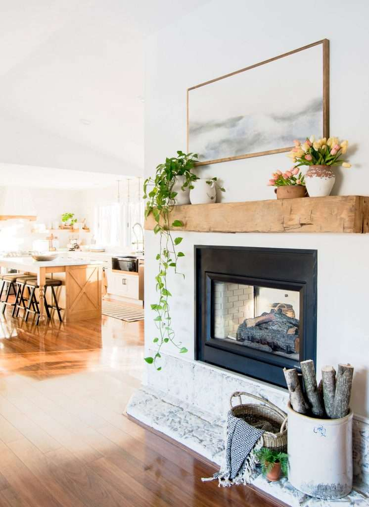 Fireplace with kitchen in the background.