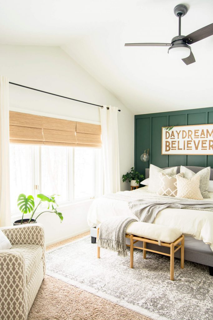 Modern farmhouse bedroom with green wall.