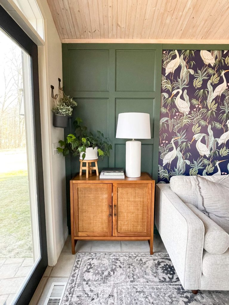Green wainscoting with side table