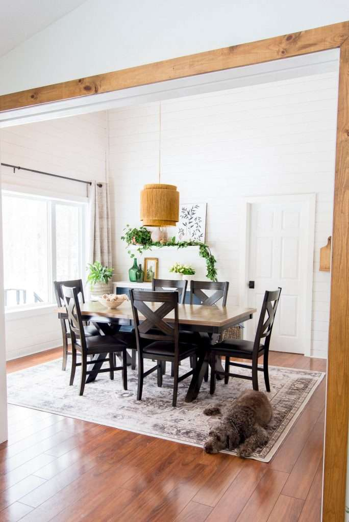 Dining room with plants.