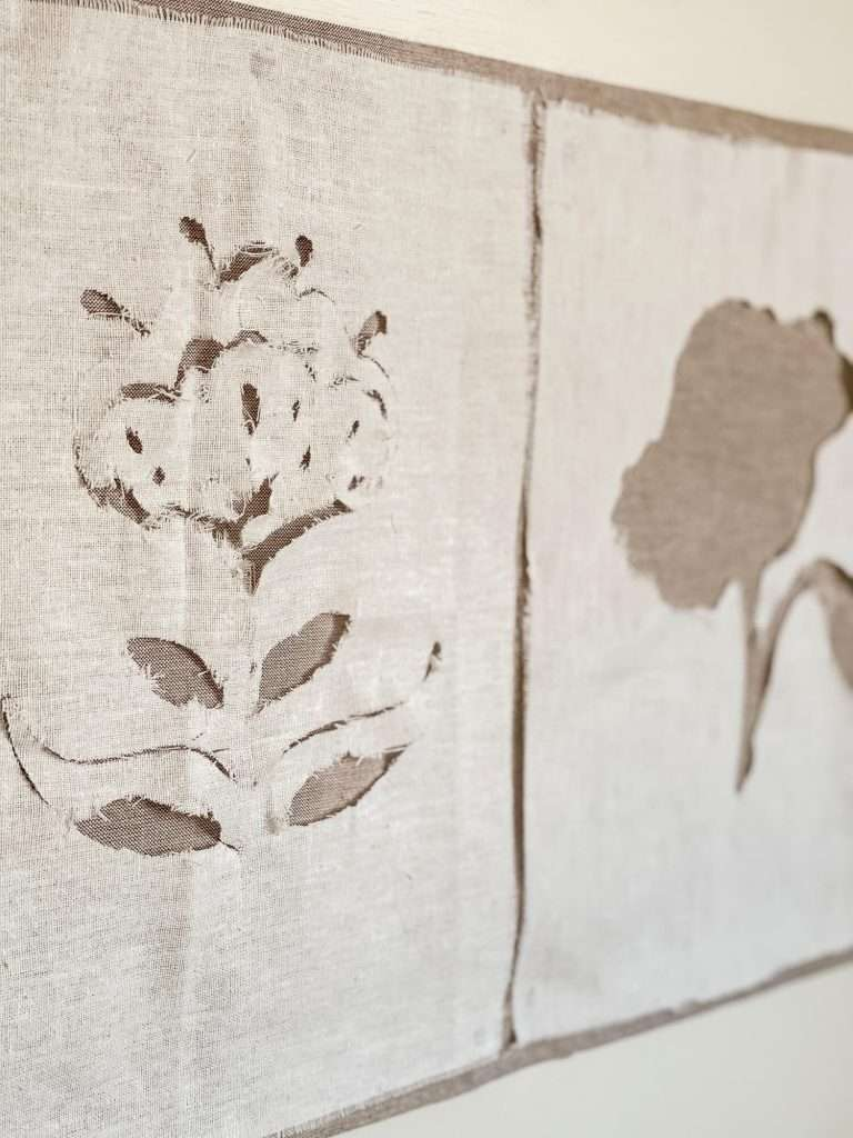 Cut out flowers on fabric