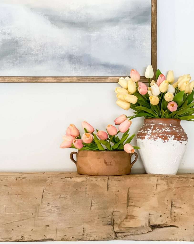 Faux tulips on a mantel.