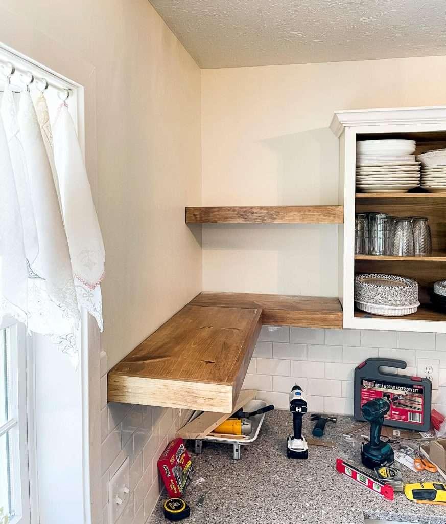Installing floating corner shelves.