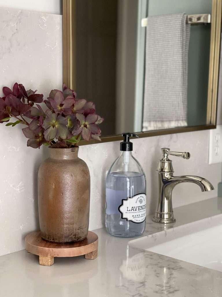 Flowers by a bathroom sink
