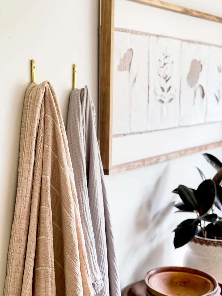 organic blankets hanging on a wall