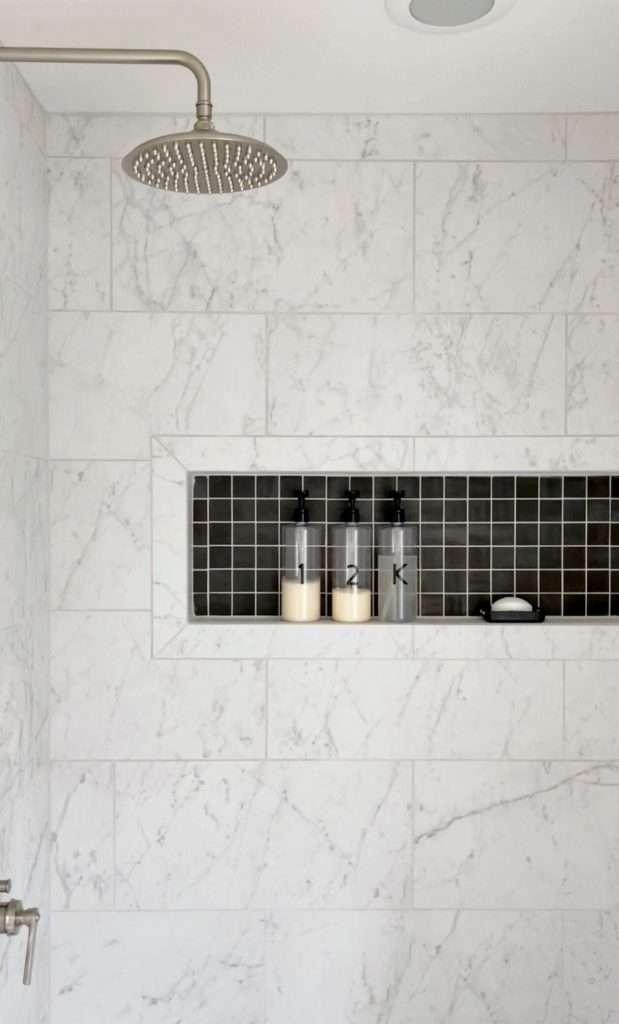 Shampoo bottles in a shower niche