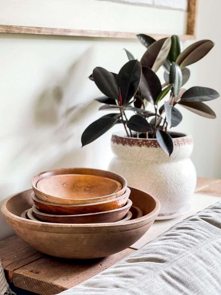 Vintage wood bowls in an organic modern living room.
