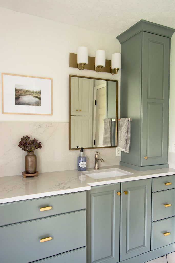 Bathroom remodel with green vanity.