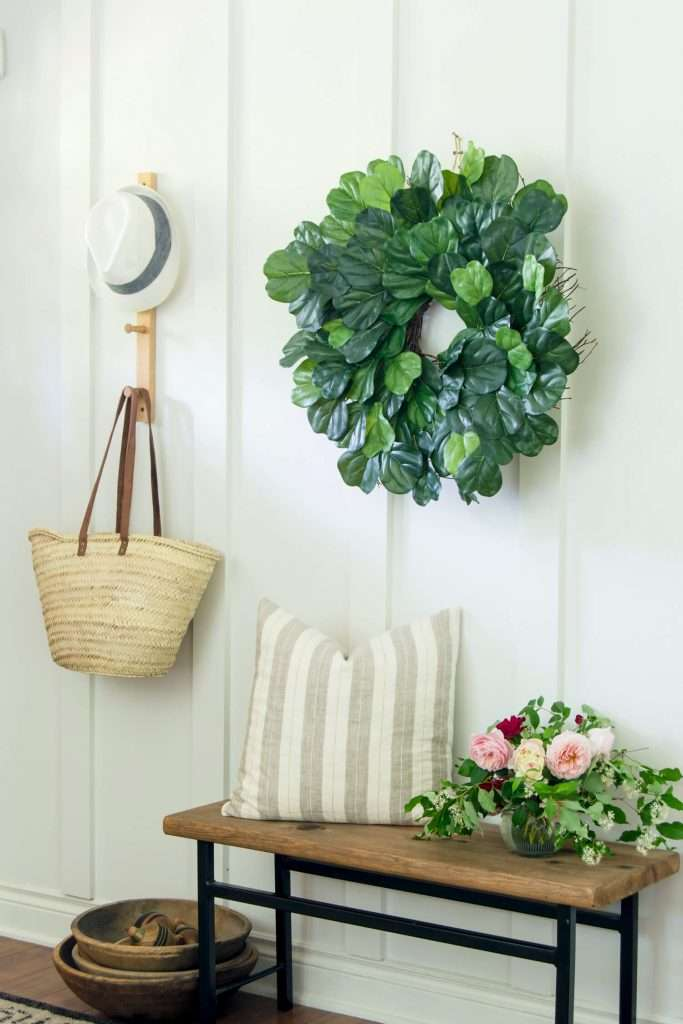 Fig wreath on a board and batten entryway.