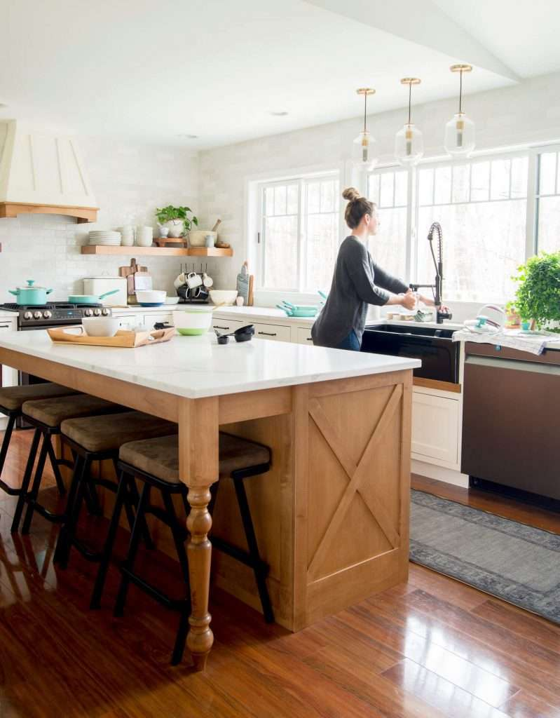 Woman washing dishes in a beautiful kitchen