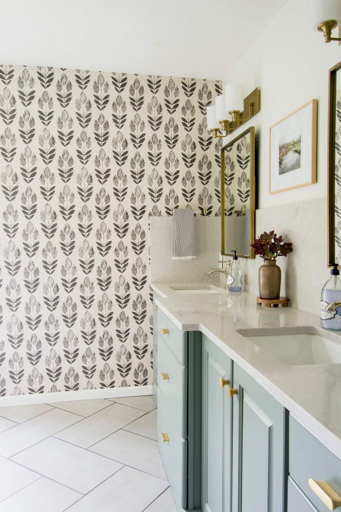 Bathroom vanity with wallpaper.