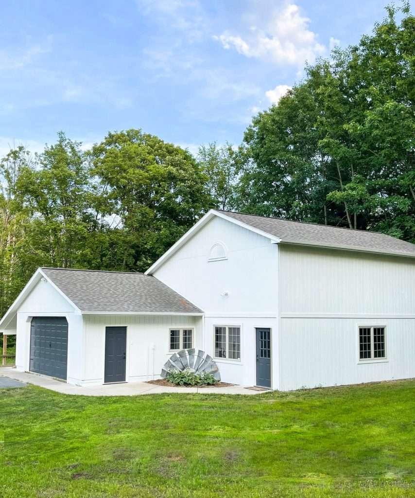 White barn with grey doors