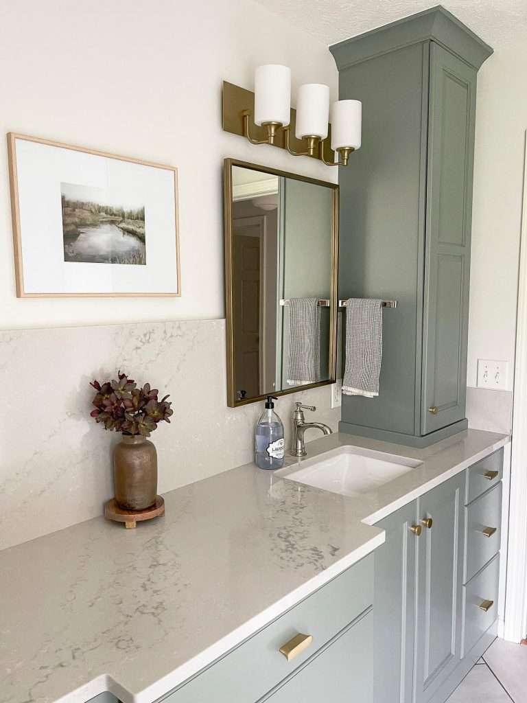 Quartz countertops in a bathroom.