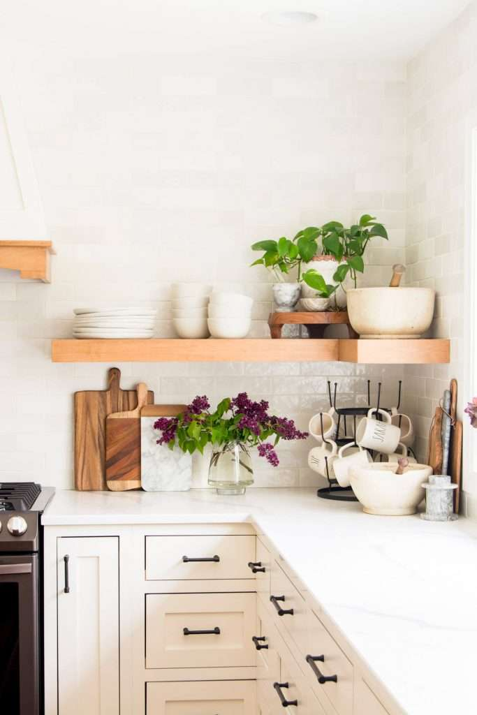 Opening shelf kitchen styling with dishes.