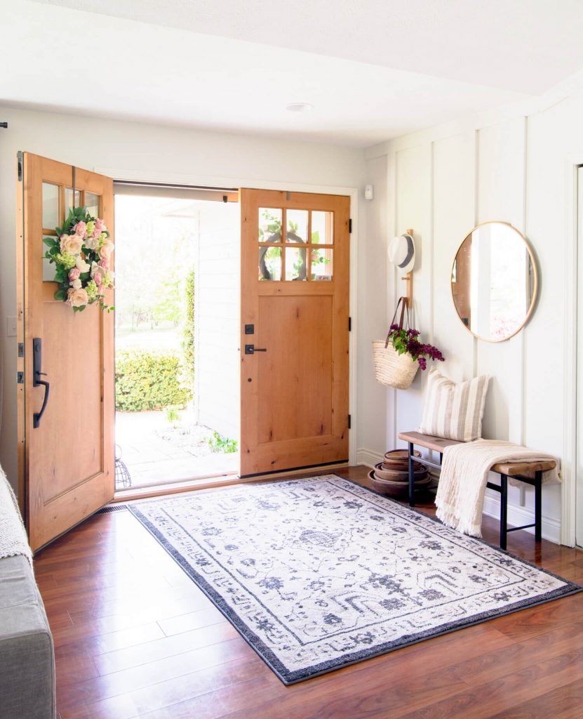 Entryway with board and batten and double doors.