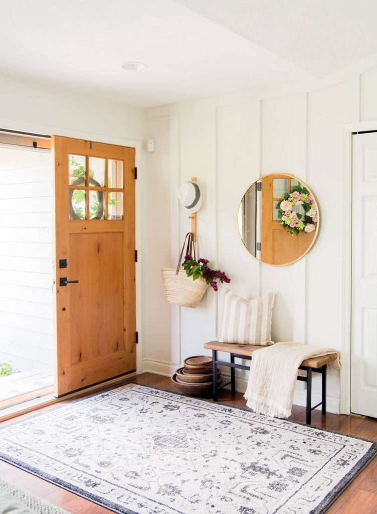 Entryway design with wood wall treatment.