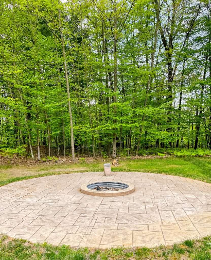 Large custom fire pit in the backyard