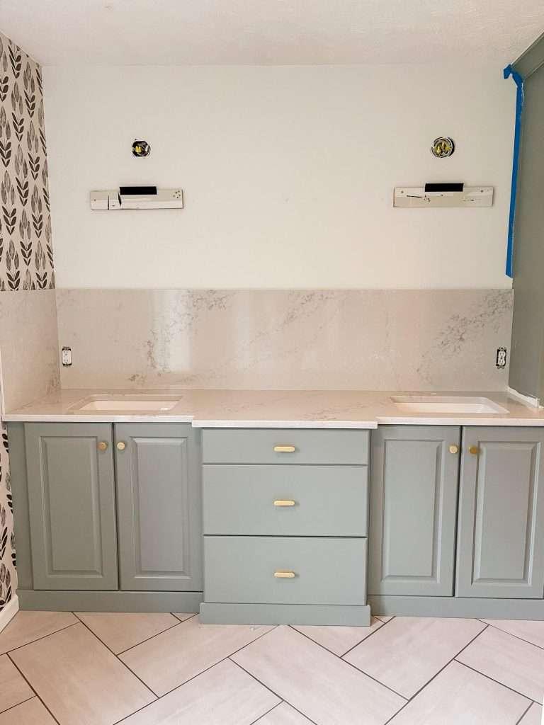 Bathroom remodel quartz backsplash.