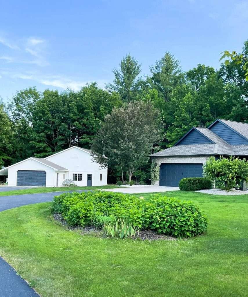 Black exterior with a white exterior barn.