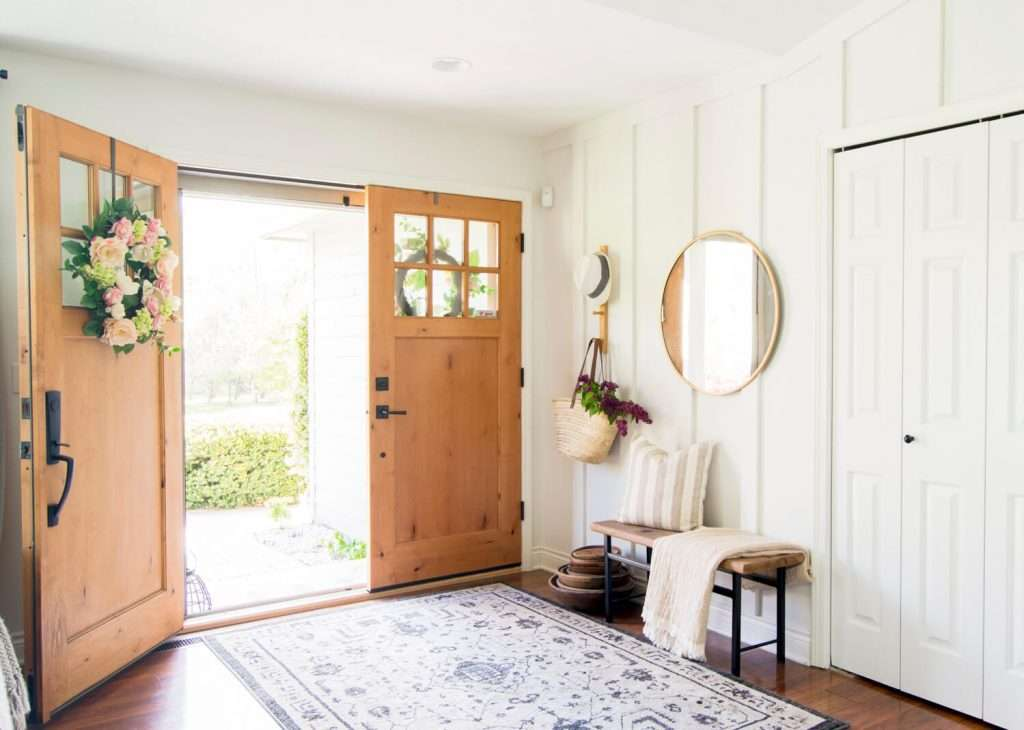 Board and batten entryway with double doors.