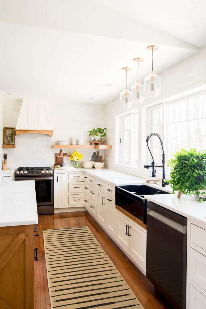 Black farmhouse sink with kitchen counter styling