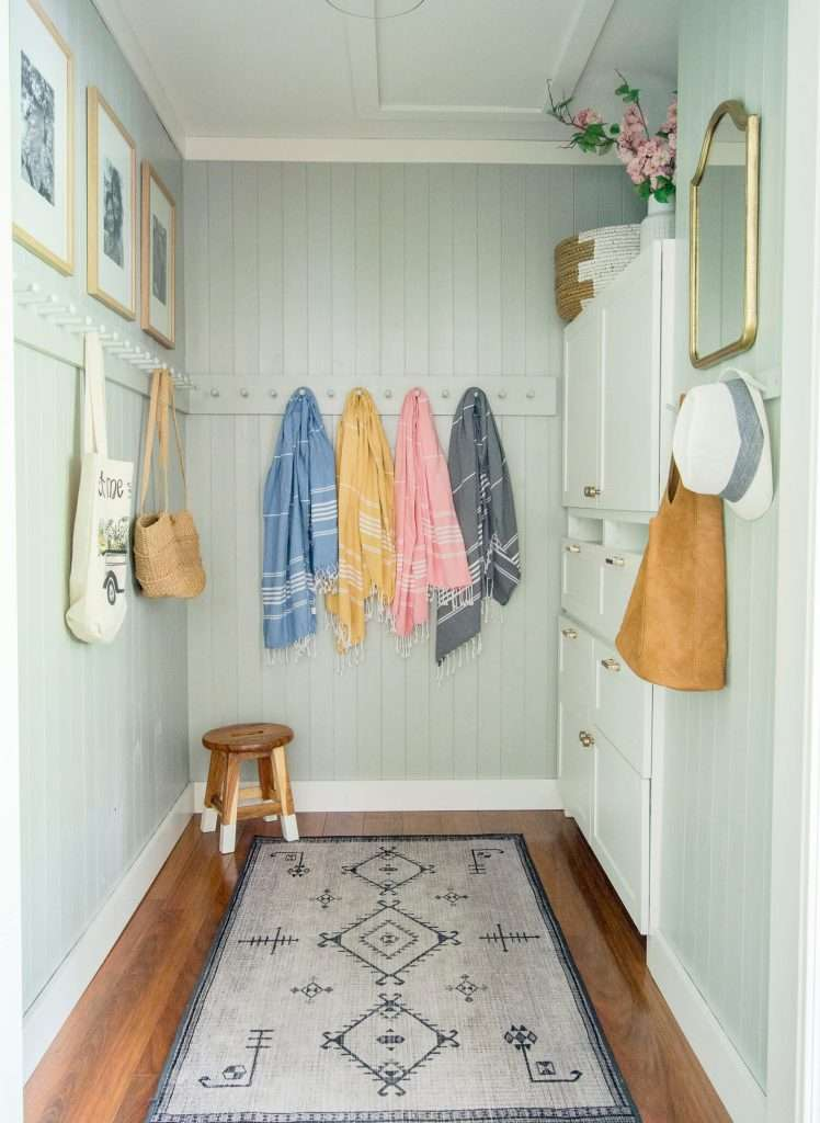 Hanging beach towels in a mudroom.