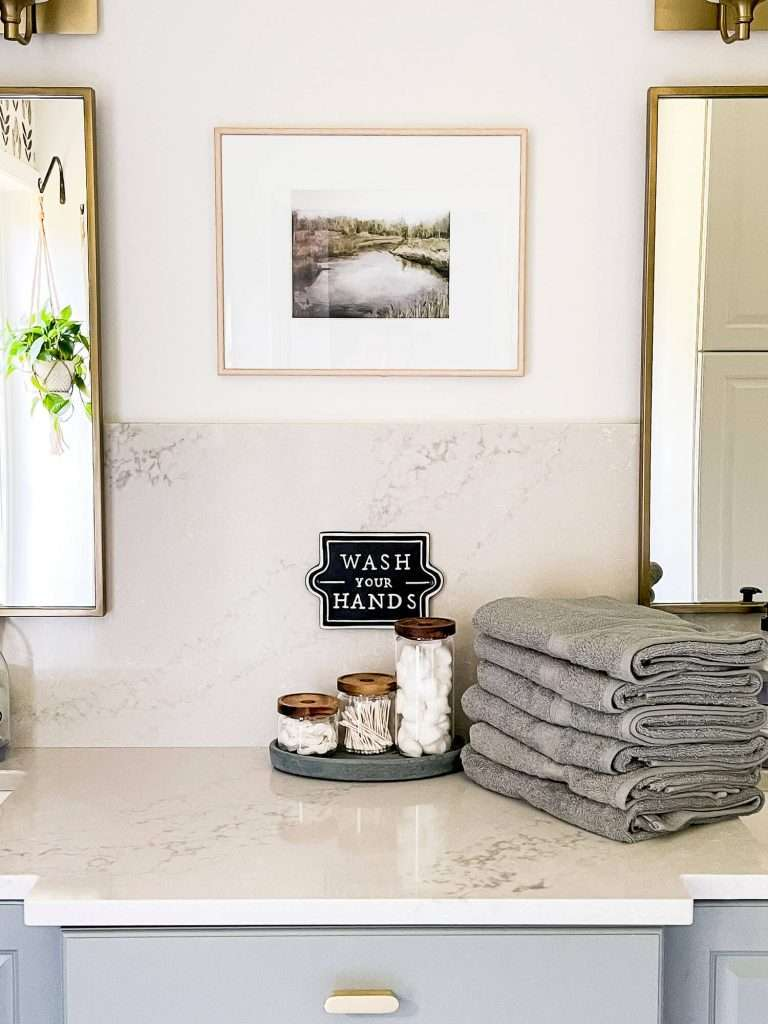 Bath towels and canister set on quartz countertop