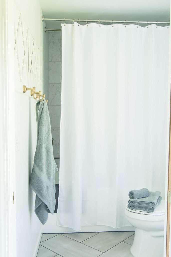bathroom essentials list with towels
