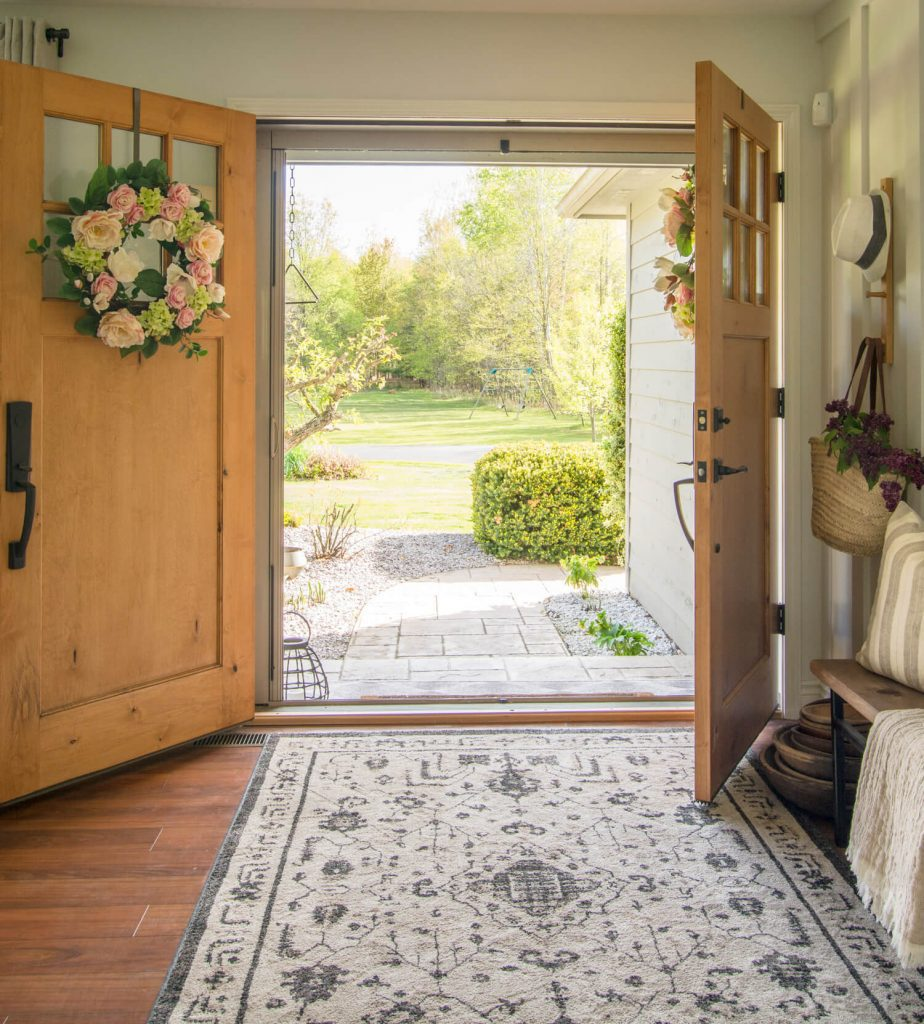 Double doors open to a front yard