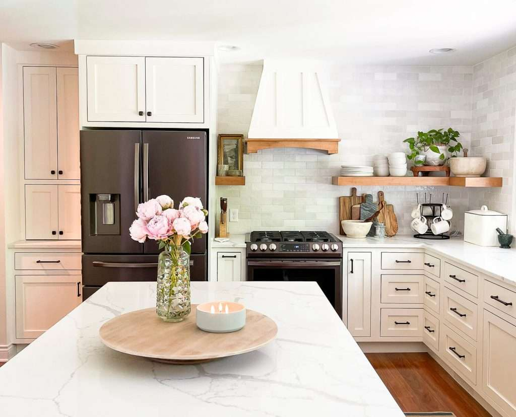 White kitchen with wood accents.
