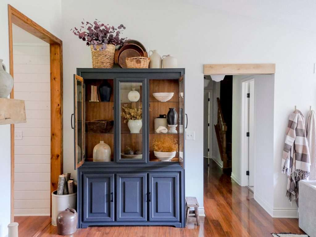 Dried eucalyptus in a  black cabinet