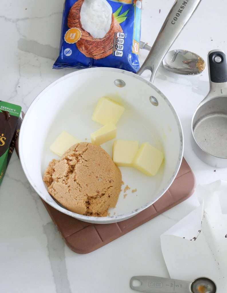 Butter and sugar in a pot.